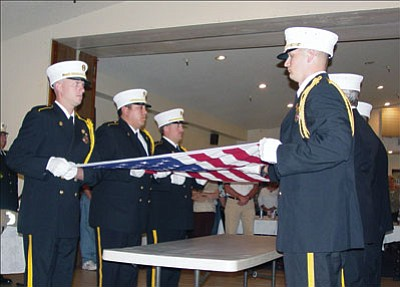 Courtesy<br><br> The Kingman Fire Department Honor Guard performs a flag service at a memorial ceremony for Nolan Davis on Oct. 29, 2007, at the Kingman Elks Lodge. Davis served as a volunteer firefighter with KFD for 25 years.