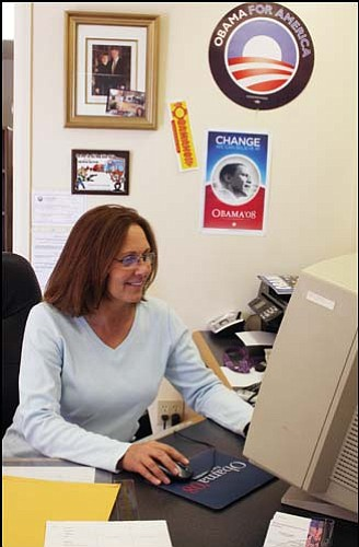 JC AMBERLYN/Miner<br> Mary Landahl works at the computer at the Democratic Headquarters in Kingman recently.