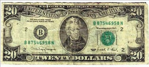 KPD/courtesy<br><br> This is one of two counterfeit $20 bills KPD collected from two local retailers. The department is warning residents to take a closer look at their money during the holiday season. This one had the same serial number as the other counterfeit.