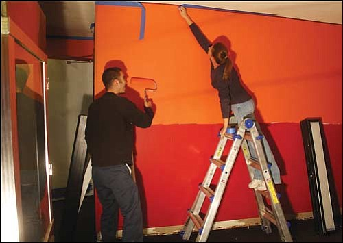 JC AMBERLYN/Miner<br> Jason Holt and Deborah Librea put a fresh coat of paint on the lobby walls at Brenden Theatres Kingman Cinema recently. Water damage has pushed back the opening of the four-theater complex to Dec. 19.