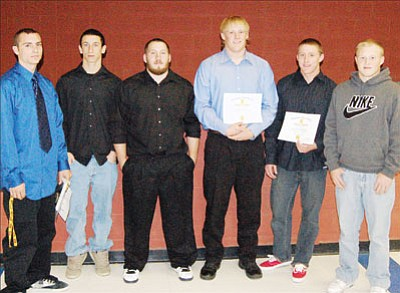 SHAWN BYRNE/Miner From left, John Scott, Steven Demoruelle, Kyle Lombardi, Kevin Nowicki, Andrew Thibodeau and Andrew Link were recently named to the All-Northwest Region teams for the Kingman High Bulldogs.