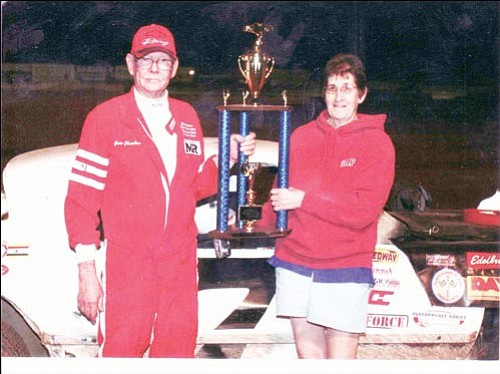 Courtesy<br><br> Gene Chambers, with his wife, Jen, accepts the trophy for the 2008 Street Stock season championship he won at the Mohave Valley Raceway. Chambers, 73, has won four season championships in the last seven years.