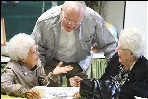 JC AMBERLYN/Miner Betty (Clack) Grounds (left), Roy Dunton and Kathryne Casson reminisce Wednesday during the 80th anniversary celebration of Palo Christi Elementary School in downtown Kingman.