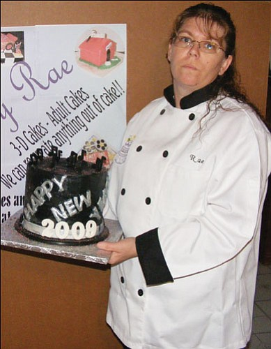 Courtesy<br><br> Cakes By Rae owner Rae Plumley presents a 3-D top hat cake she designed to ring in the New Year.
