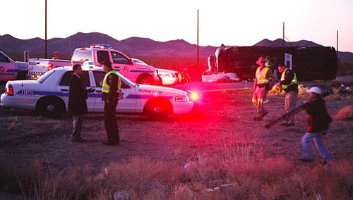 JC AMBERLYN/Miner<br> Seven people died after a tour bus flipped over near Rosie's Den cafeteria along U.S. 93 north of Dolan Springs, Ariz.