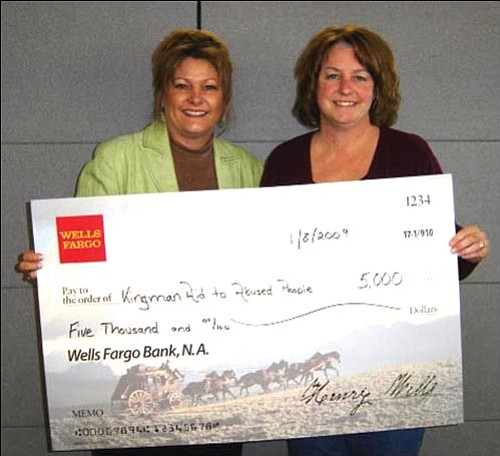 Courtesy<br><br> Misty Howell, left, Wells Fargo Community Banking president, presents a $5,000 check to KAAP Executive Director Suzanne Clarke.