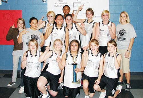 Courtesy<br><br> The White Cliffs Middle School 8th-grade girls basketball team celebrates winning the Mohave Valley Junior High Bulldog Classic.