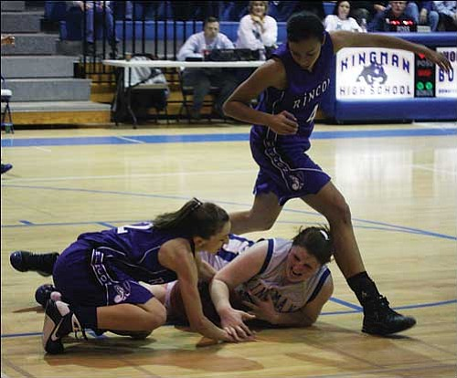 JC AMBERLYN/Miner Kingman's Sarah Murphy goes to the floor and battles a Tucson Rincon player for a loose ball Wednesday night.