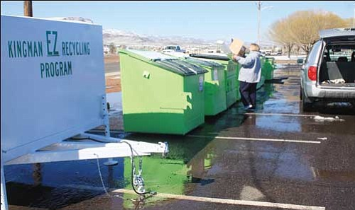 JC AMBERLYN/Miner Chlorissa Awik is pictured recently taking advantage of the new recycling program in Kingman located in the parking lot of Centennial Park along Burbank Street. The Kingman EZ Recycling Program has containers for clear plastic bottles, newspaper, cardboard and electronic waste.