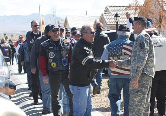 A long line of motorcyclists, civilians and others lined up to shake Lee Duay's hand in a surprise visit to his home Saturday morning. Photo by JC Amberlyn.
