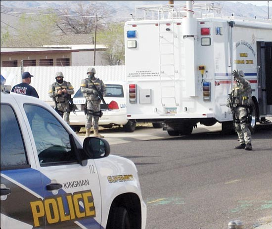 Bullhead City SWAT members suit up Tuesday afternoon in anticipation of entering a home on Chambers Avenue in Kingman. The team was called by Kingman Police Department in response to a possible murder/suicide. KPD does not have its own SWAT team. SUZANNE ADAMS/Miner