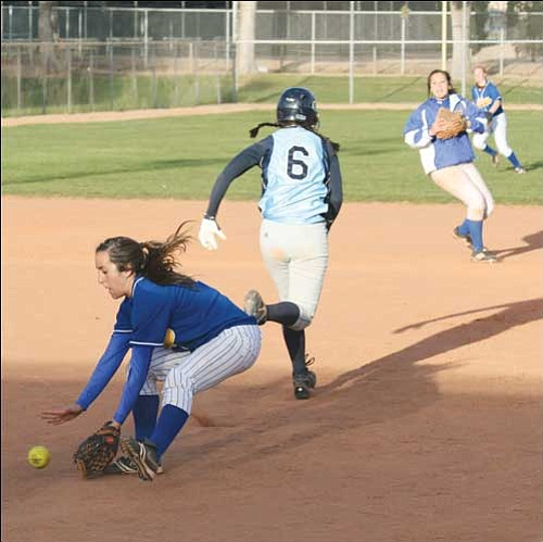 JC AMBERLYN/Miner Kingman High's second baseman Kyra Williams scoops up a grounder against Window Rock Friday.