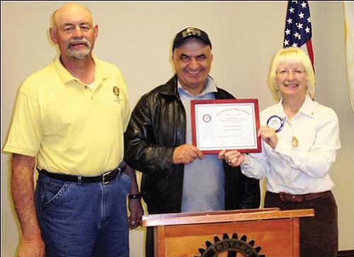 Courtesy<br /><br /><!-- 1upcrlf2 -->John Mirkovich (center) is pictured with Route 66 Rotary Club President Lee Fabrizio and club Public Relations Chairwoman JoAnn Oxsen as he accepts the Rotary Citizen of the Month award.