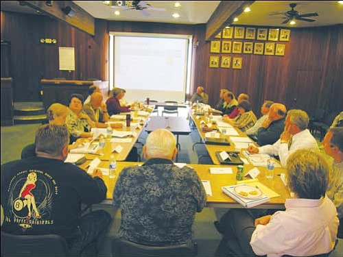 JAMES CHILTON/Miner The Kingman City Council and staff go over the budget at a special meeting Thursday.