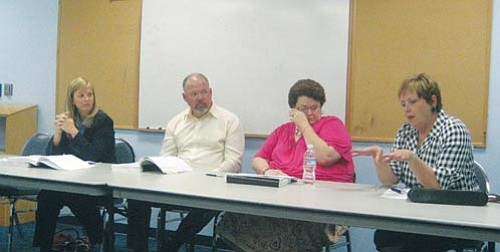 SUZANNE ADAMS/Miner<br><br> Kingman City Finance Director Coral Loyd, Mayor John Salem and Councilwoman Robin Gordon watch as Councilwoman Janet Watson explains how the city has cut spending.