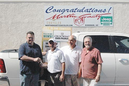 SHAWN BYRNE/Miner<br><br> Gene Suggs, second from left, receives the keys to the Dodge Ram he won Saturday from Cody Swanty of Martin Swanty Chrysler Dodge Jeep Wednesday. Tournament director Chuck Sperrazza, third from left, and Martin Swanty were on hand to turn the truck over to Suggs.
