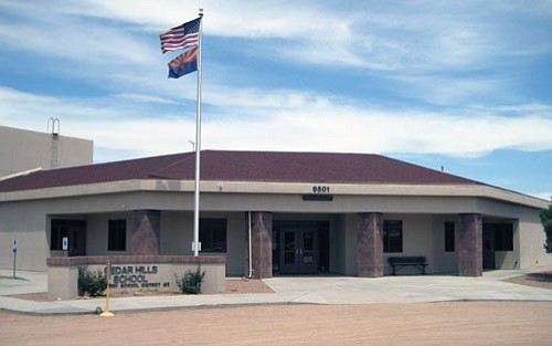 AARON ROYSTER/Miner<br><br> The U.S. flag and Arizona flag whip in the wind in front of Cedar Hills, the only school in the Hackberry Elementary School District.