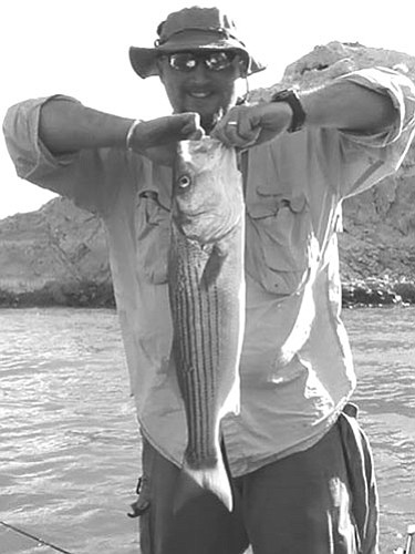 Courtesy<br><Br> Johnnie Hoeft holds a big striper he caught during the United Professional Fire Fighter's of Kingman tournament on Saturday at South Cove. The fish weighed 5.7 pounds and was the largest taken during the tournament.