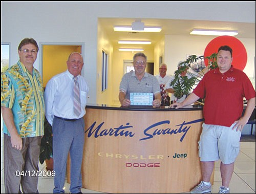 Courtesy<br> Kingman Parks and Recreation Superintendent Keith Adams (left) poses with Curtis Cutshaw, Martin Swanty and Cody Swanty to note the sponsorship of the Summer Movie in the Park on July 24 by Martin Swanty Chrysler Dodge Jeep.