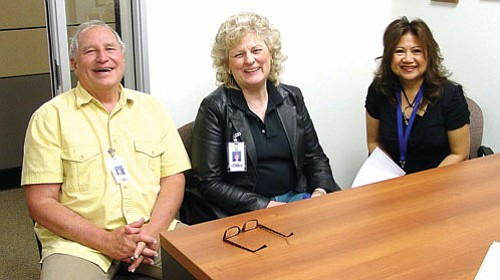 Mohave County/courtesy<br><br> Mohave County One-Stop Career Center employees (from left) Bill Hargrove, Madelyn Shaffer and Lynne Steiger discuss Title V job opportunities for seniors recently at the County Administration Building in Kingman.