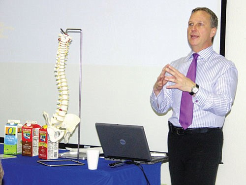 "Courtesy<br><Br> Dr. Robert Lock presented ""Fit to a T,"" a bone health and osteoporosis education program on May 8 to a group at Coffee at the College on Mohave Community College's Neal campus in Kingman. Lock, who specializes in orthopedics in the tri-state area, was sponsored by MCC's Community Outreach program. His one-hour program focused on bone health, osteoporosis and how to avoid fragility fractures."
