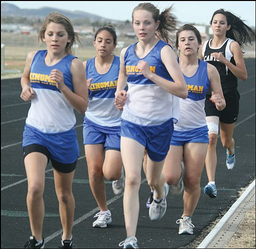 JC AMBERLYN/Miner<br> Kingman High's Hillary Acer leads the pack in this photo from an earlier meet. Acer took nearly 20 seconds off her time in the 3,200-meter to take 12th place at the state meet last week in Chandler.