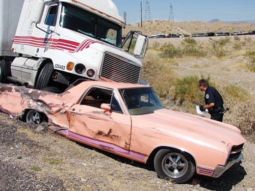 Bullhead City Fire Department/ Courtesy<br><Br> A semi-truck carrying potassium siliconate lost its brakes on Highway 68 into Bullhead City Monday afternoon. The truck struck several vehicles resulting in eight people injured before coming to a rest on this El Camino.