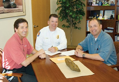 KRMC/Courtesy<br><Br> From left, Kingman Regional Medical Center CEO Brian Turney, Northern Consolidated Fire District Fire Chief Patrick Moore and Mike Ward, medical director for KRMC's Emergency Department and Arizona Emergency Medical specialist sign a new base hospital agreement, which becomes effective July 1.