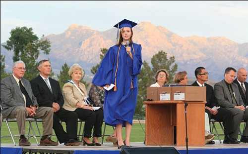 JC Amberlyn/MINER<br><Br> With the Hualapai Mountains serving as a backdrop, Julya Walters-Koalska sings on stage during Kingman Academy of Learning High School's graduation ceremonies Thursday night on Lee Williams Field.