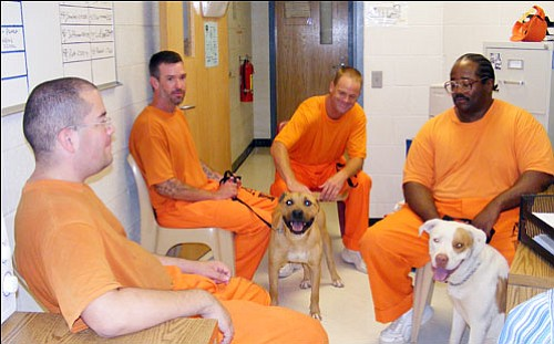Arizona State Prison/Courtesy<br><Br> Inmates Ernest Zarza, Rod Knagge, Randy Barrow and Theo Randall talk about the Friends of the Pen program and their new dogs.
