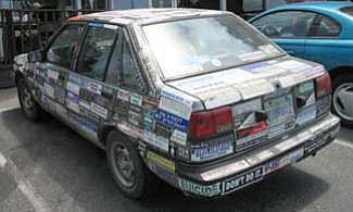 This driver went overboard with the bumper stickers for a car.