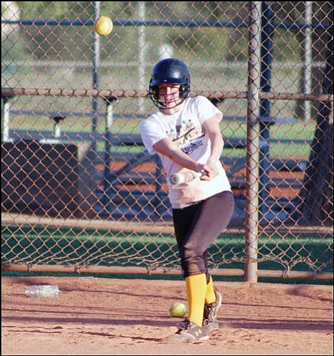 By Shawn Byrne<br> Miner Sports Writer Kingman Sidewinders' Michelle Bracy slaches a line drive up the middle during Wednesday's practice at Centennial Park. The Sidewinders will be in Prescott for the Best of the West Championships this weekend.