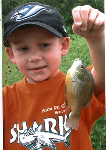 "DON MARTIN/For the Miner<br><br> Seven-year-old Logan Martin displays the bluegill that he caught while fishing with his grandfather, outdoors writer Don Martin, during a recent trip in Oklahoma.<a href=""http://kingmandailyminer.com/Formlayout.asp?formcall=userform&form=20"">Click here to purchase this photo</a>"