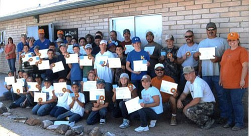 "DON MARTIN/For the Miner<br><Br> The Arizona Hunter Education program graduated 38 students at ceremonies Sunday at the Mohave Sportsman Club's 7-Mile Hill Range.<a href=""http://kingmandailyminer.com/Formlayout.asp?formcall=userform&form=20"">Click here to purchase this photo</a>"