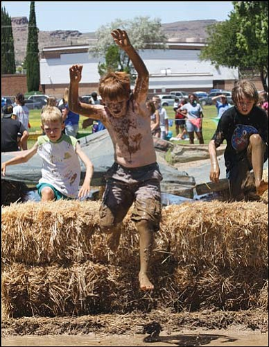 "JC AMBERLYN/Miner<br> Sean McMullen leaps over a haystack during Mighty Mud Mania Aug. 6. <b><a href=""Formlayout.asp?formcall=userform&form=20""target=""_blank"">Click here to purchase this image as a print or photo gift</a></b>"