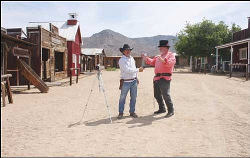 "Kirk Slack (left) and Jim ""Pistol Packin' Jim"" Smith are the co-founders of Out West Family Films. They are shown posing in front of the ""Wild West town"" set in Chloride Friday morning. <b><a href=""Formlayout.asp?formcall=userform&form=20""target=""_blank"">Click here to purchase this image as a print or photo gift</a></b>"