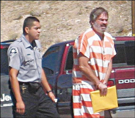 Darrell Ketchner is led from court to the Mohave County Jail following a hearing Friday.