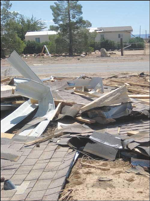 ERIN TAYLOR/Miner  The roof of this Golden Valley home ended up across the street after a powerful storm struck Friday night.