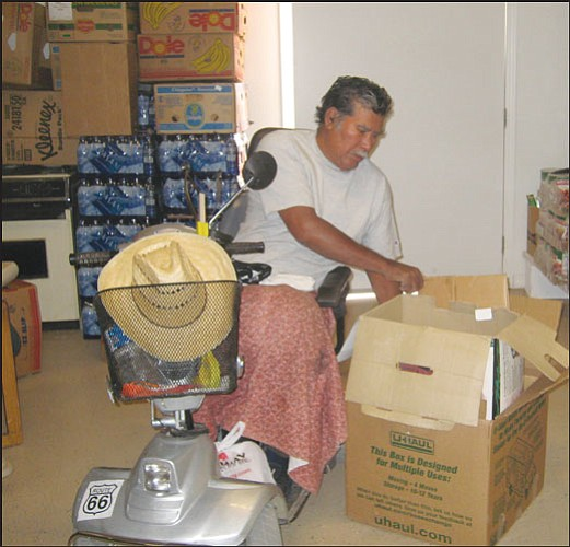 "ERIN TAYLOR/Miner  Francisco Balvastro has volunteered for St. Vincent de Paul for three years breaking down boxes for the organization.  <b><a href=""Formlayout.asp?formcall=userform&form=20""target=""_blank"">Click here to purchase this image as a print or photo gift</a></b>"