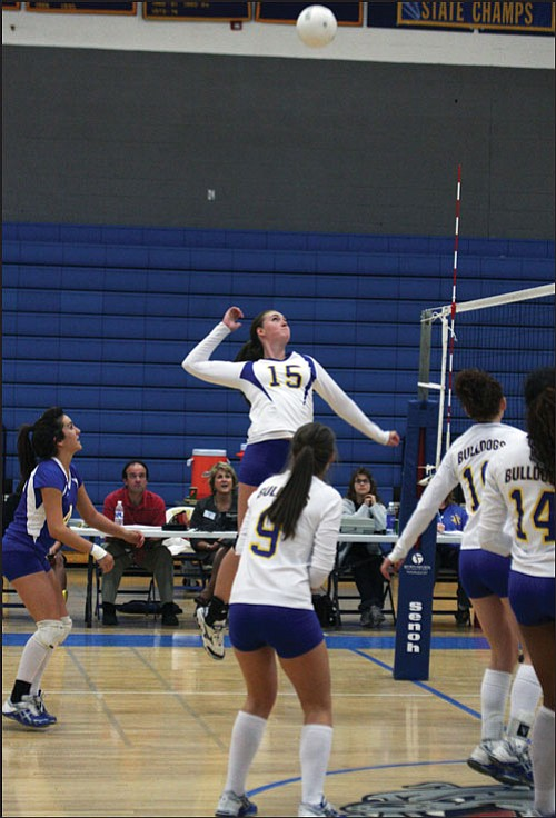 """JC AMBERLYN/Miner Kingman High's Kate Ballenger (15) goes up for one of her four kills during the Bulldogs' sweep of Goldwater Tuesday at KHS. Rachelle Bullen (9), Tesla Morgan (10) and Dominique Hale (14) look on in Ballenger's first start of the year. <b><a href=""""Formlayout.asp?formcall=userform&form=20""""target=""""_blank"""">Click here to purchase this image as a print or photo gift</a></b>"""