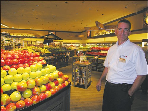 "JAMES CHILTON/Miner Carl Gibbs, manager of the newly-renovated Safeway at 3125 Stockton Hill Road, stands in the store's redone produce section, which features warmer spotlighting in place of old fluorescents and a wooden floor in place of tiles.   <b><a href=""Formlayout.asp?formcall=userform&form=20""target=""_blank"">Click here to purchase this image as a print or photo gift</a></b>"