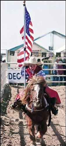 Courtesy<br> Dawson Lee Honeycutt, 5, will lead the charge at the 25th Annual Andy Devine Days Rodeo this weekend at the Mohave County Fairgrounds. Riley Honeycutt, 3, will lead the crowd with the Pledge of Allegiance as well.