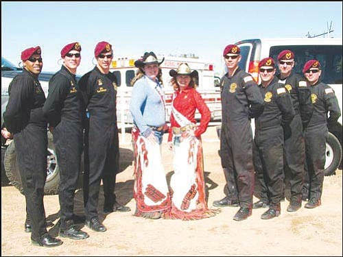 Courtesy<br> Outgoing Andy Devine Days Rodeo Princess Jessica Head, left, and outgoing Queen Cristyn Peacock are pictured with the United States Army Parachute Team, the Golden Knights. The photo was taken after Head and Peacock performed in the Yuma Rodeo on Feb. 14.