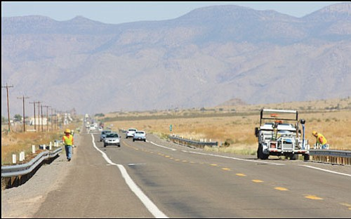 JC AMBERLYN/Miner<br> ADOT personnel work on fixing railing along Route 66 near the site of the accident Tuesday.