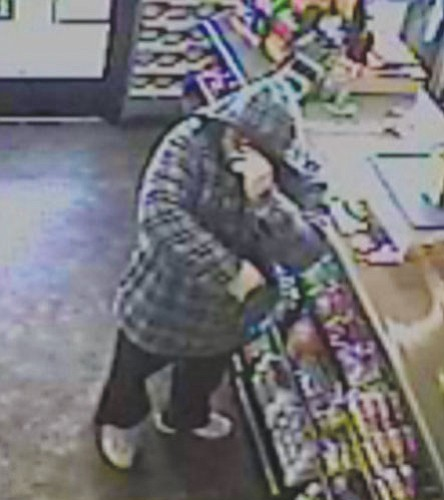 Courtesy<Br><br> Surveillance video of the Gas n Grub armed robbery suspect.