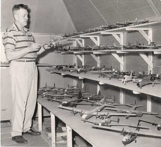 Dad with some of the 600 planes he built.