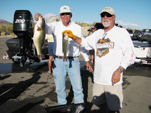 Courtesy<Br><BR> Art Fuller and his partner, Jimmy Jones, show a pair of the bass they caught at the KBC bass tourney at Alamo Lake. Fuller's bass weighed 5.64 pounds and was the largest fish caught in the two day tournament.