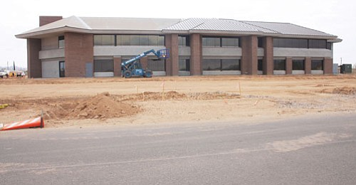 "JC AMBERLYN/Miner<Br><Br> The new County Development Services Building on Kino Avenue is on schedule and on budget. The new facility will house County Planning and Zoning, Flood Control, Economic Development, Building, Emergency Services and Environmental Health offices.<br><a href=""Formlayout.asp?formcall=userform&form=20""target=""_blank"">Click here to purchase this photo</a>"