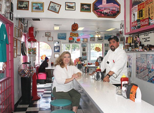 "JC AMBERLYN/Miner<Br><BR> Michelle Jimenez and her husband Armando lease Mr. D'z Route 66 Diner from the Dunton family. The restaurant was recently rated as the No. 2 diner in the state by ""Arizona Highways.""<BR><a href=""Formlayout.asp?formcall=userform&form=20""target=""_blank"">Click here to purchase this photo</a>"