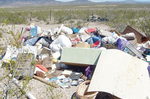 Mohave County/Courtesy<br><BR> A licensed contractor who cleaned up a foreclosed property in Kingman and then dumped this pile of trash in the desert near Temple Bar Road was tracked down by Mohave County Environmental Rural Area Cleanup Enforcement.